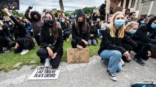 June 6, 2020, Munich, Bavaria, Germany: Demonstrators in Munich, Germany take a knee against racism. Showing solidarity