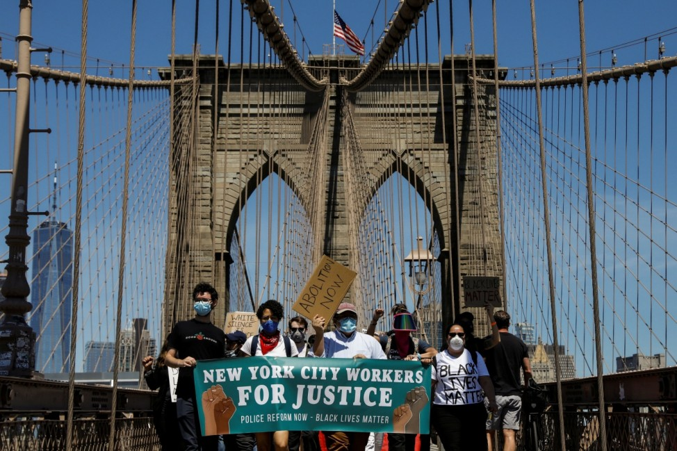 Current and former New York City Mayor's staff march across the Brooklyn Bridge to call for reforms during a protest against racial inequality in the aftermath of the death in Minneapolis police custody of George Floyd, in New York