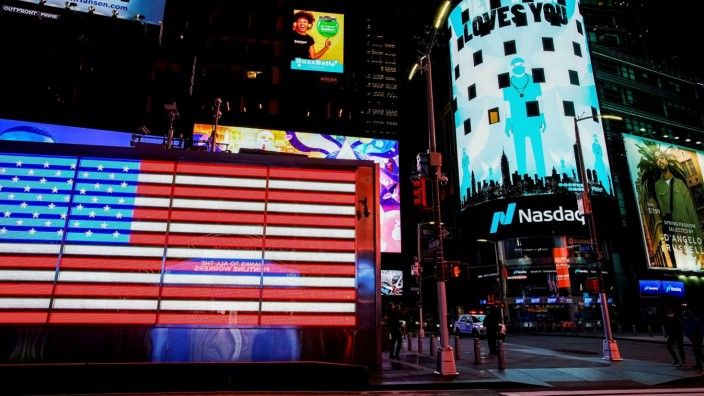 FILE PHOTO: Times Square is illuminated in blue as part of the 'Light It Blue' initiative to honor healthcare workers, during the outbreak of the coronavirus disease (COVID-19) in New York