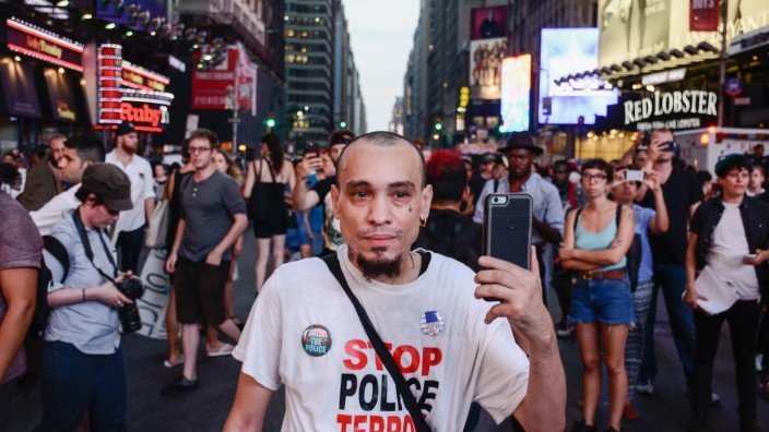 USA: Black Lives Matter Protest in New York City Joshua Lopez doing the Cop Watch. Thousands Marched through the street