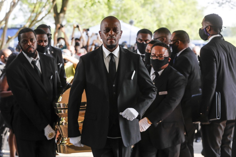 Pallbearers bring the coffin of George Floyd into The Fountain of Praise church for his funeral at in Houston, Texas on