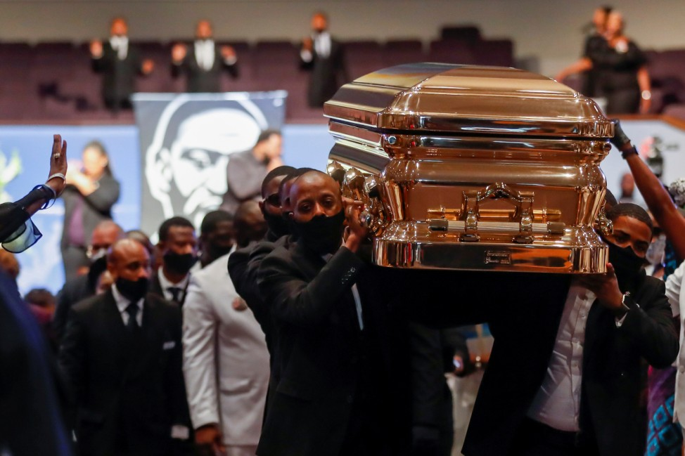Pallbearers recess out of the church with the casket following the funeral for George Floyd at The Fountain of Praise church in Houston
