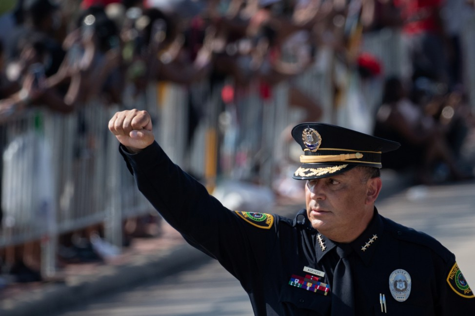 Houston Police Chief Art Acevedo raises his hand during funeral procession for George Floyd ahead of burial in Pearland, Texas