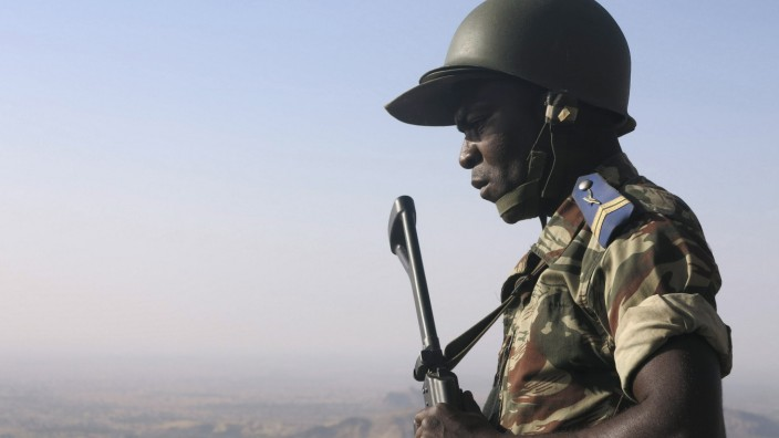 A Cameroonian soldier stands guard at an observation post on a hill in the Mandara Mountain chain in Mabass overlooking Nigeria