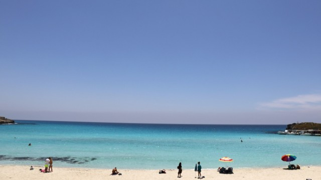 Beachgoes are seen in Nissi Beach in the resort of Ayia Napa