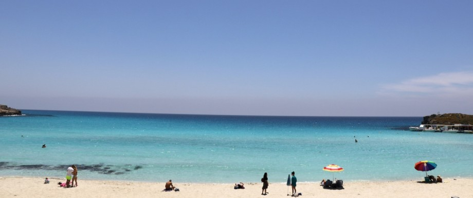 Beachgoes are seen in Nissi Beach in the resort of Ayia Napa