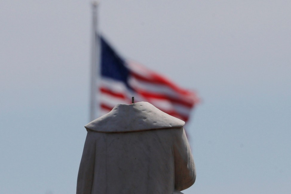 The head of a statue of Christopher Columbus was pulled off overnight in Boston