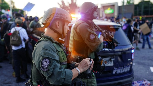 Atlanta SWAT officers are seen with weapons out during a rally against racial inequality and the police shooting death of Rayshard Brooks, in Atlanta