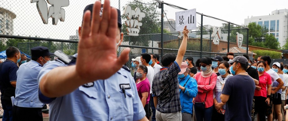 People line up to get a nucleic acid test at a sport center after a spike of cases of the coronavirus disease (COVID-19), in Beijing