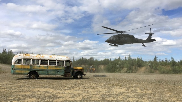 Alaska Army National Guard helicopter hovers near 'Bus 142' near Stampede Road