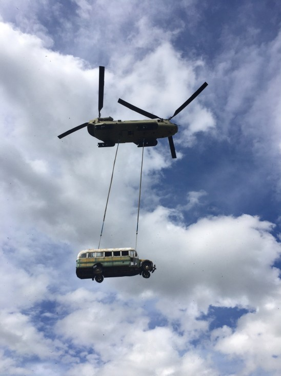 laska Army National Guard CH-47 Chinook helicopter carries the bus made famous by the 'Into the Wild' book and movie near Stampede Trail
