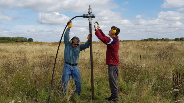 Members of the consortium which made the discovery of a wide circle of deep pits, as part of the Stonehenge Hidden Landscapes Project, conduct fieldwork in Durrington, Wiltshire