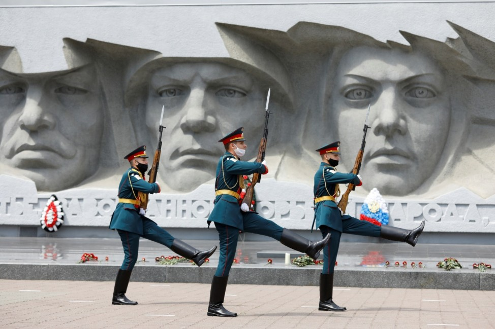 Honour guards march in front of a World War Two monument in Stavropol