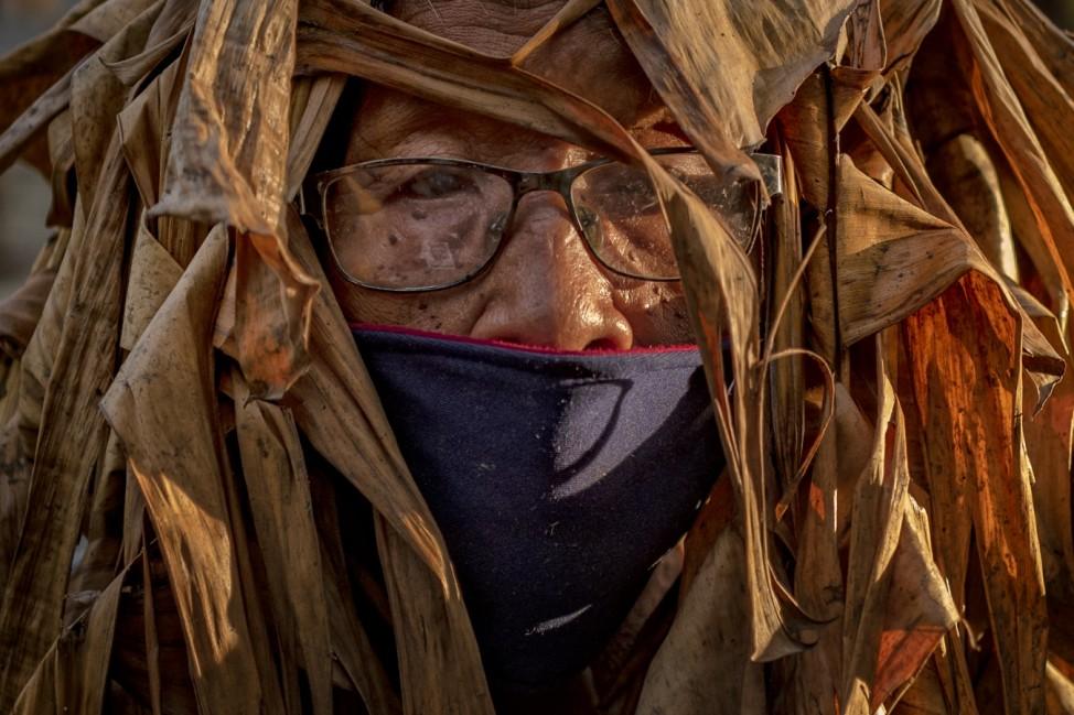 Filipino Devotees Gather For The 'Mud People' Festival Amid The Coronavirus Pandemic