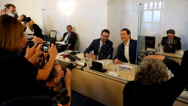 Austrian Chancellor Sebastian Kurz poses for members of the media as he waits to give testimony at a parliamentary inquiry committee in Vienna