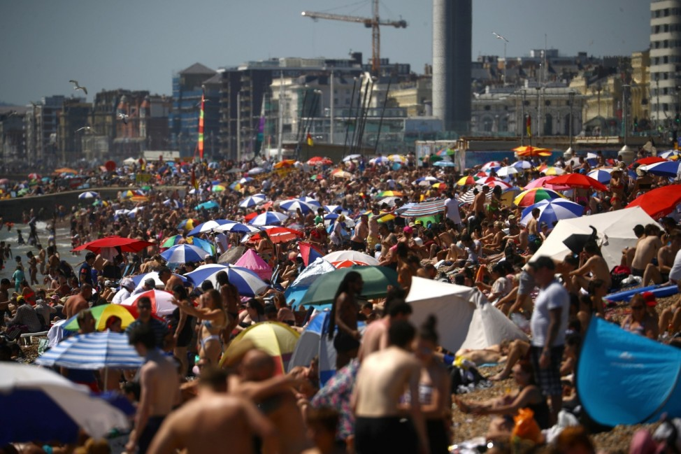 People enjoy the hot weather in Brighton