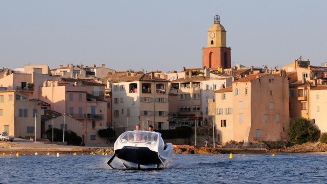SeaBubbles executives are seen aboard a prototype of their water taxi in the harbour of Saint-Tropez