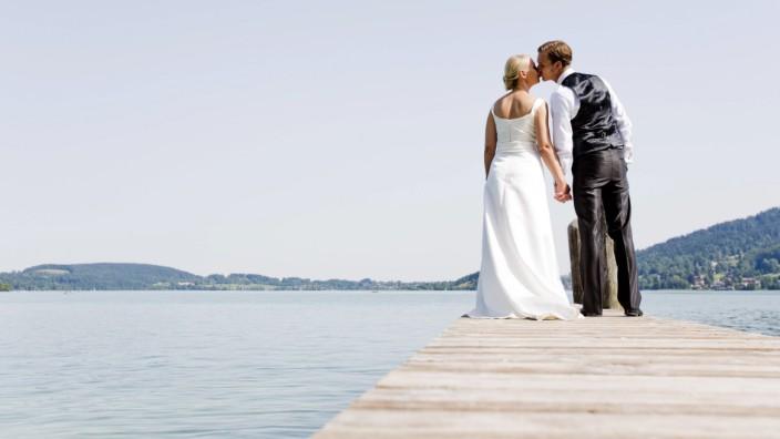 Germany Bavaria Tegernsee Wedding couple standing on jetty model released PUBLICATIONxINxGERxSUIx