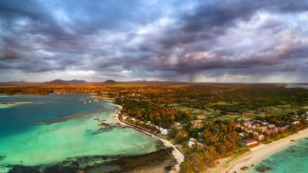 Dramatic sky at dawn over Trou d Eau Douce coastline, aerial view, Flacq district, East coast, Mauritius, Indian Ocean,