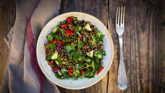 Bowl of vegan lentil salad with cucumbers, bell peppers and parsley LVF08921
