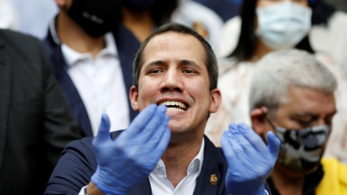 FILE PHOTO: Venezuelan opposition leader Juan Guaido  speaks during a news conference after Venezuela's pro-government supreme court replaced the leaders of two key opposition parties, months ahead of legislative elections in Caracas