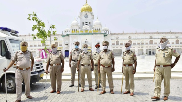 AMRITSAR, INDIA - JUNE 5: Punjab Police personnel deployed outside the Golden Temple on June 5, 2020 in Amritsar, India.