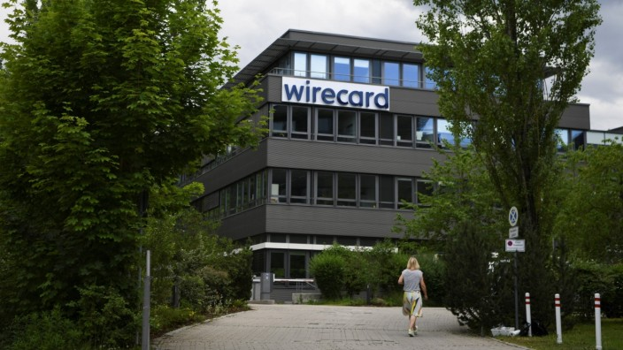 A woman enters the headquarters of Wirecard AG in Aschheim