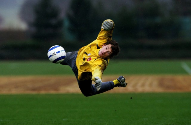 Arsenal's goalkeeper Lehmann makes save during training session at London Colney in southern England