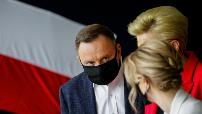 Polish President Duda visits a polling station during the second round of a presidential election in Krakow