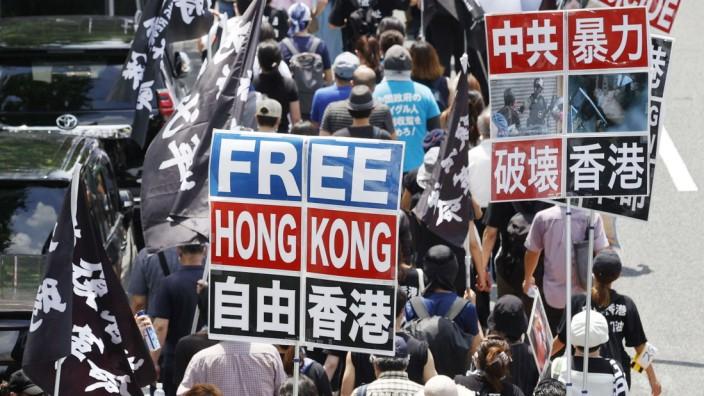 Tokio, Solidaritätskundgebung für Menschen in Hongkong Protest against security law in H.K. About 300 people, including