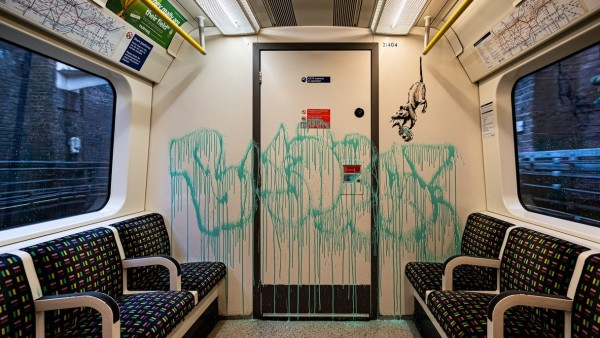 An artwork by Banksy is seen on a London underground carriage