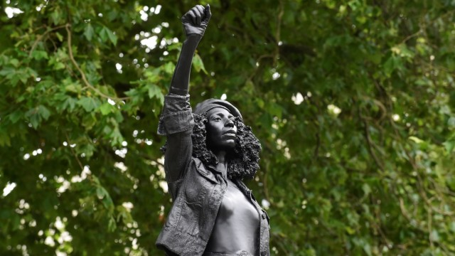 A sculpture of a Black Lives Matter protester stands on the empty plinth previously occupied by the statue of slave trader Edward Colston, in Bristol