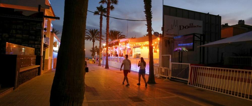 People walk in the Bierstrasse street (Miquel Pellisa street) in El Arenal beach in Mallorca