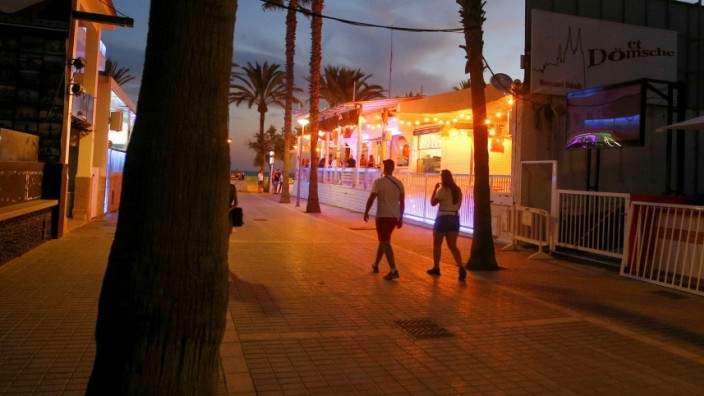 People walk in the Bierstrasse street (Miquel Pellisa street) in El Arenal beach in Mallorca