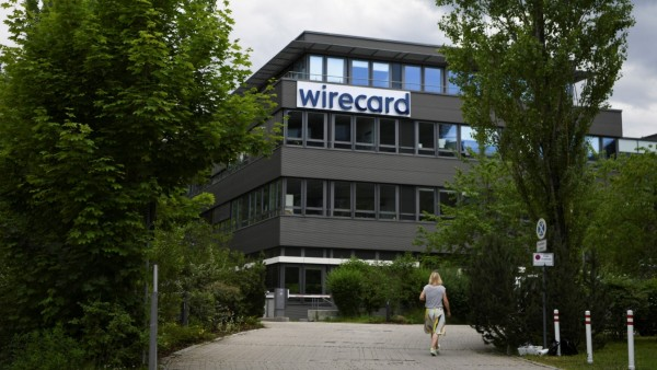 FILE PHOTO: A woman enters the headquarters of Wirecard AG in Aschheim