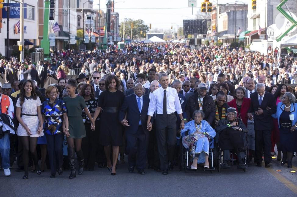March 7, 2015 - Selma, AL, United States of America - U.S. President Barack Obama marches alongside Rep. John Lewis and
