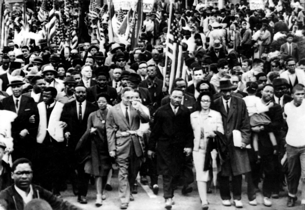 Dr Martin Luther King ( centre) leads estimated 10 000 marchers on the last leg of their Selma - to Montgomery civil ri