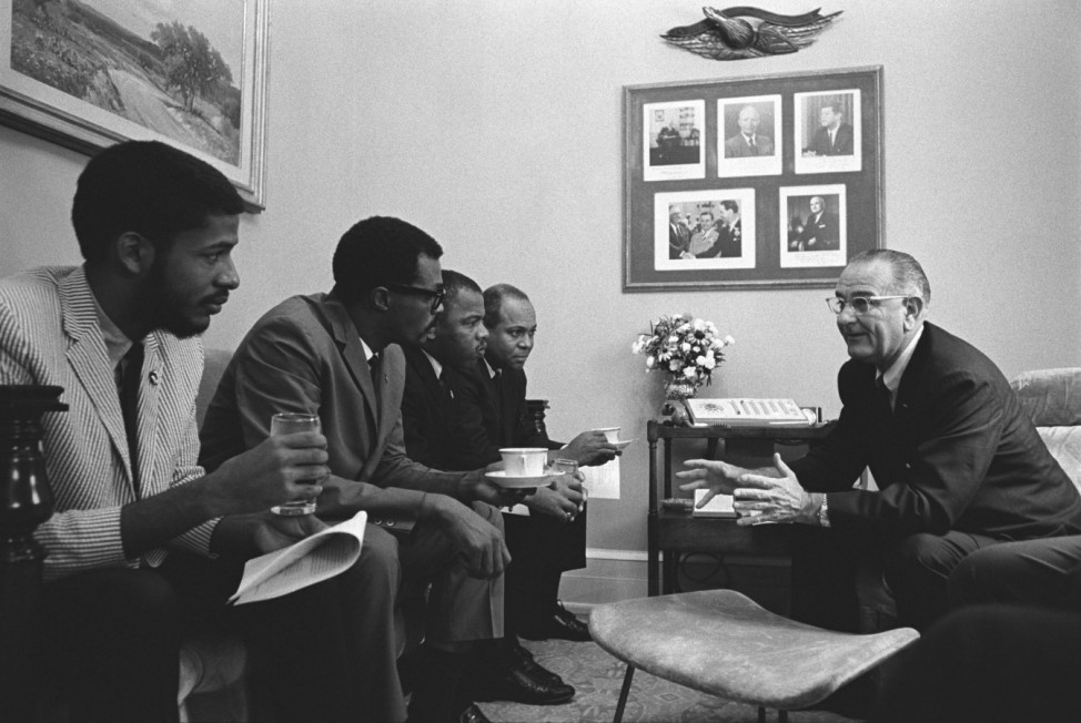 President Lyndon Johnson meeting with Civil Rights activists on the day he signed the 1965 Voting Rights Act. Seated on