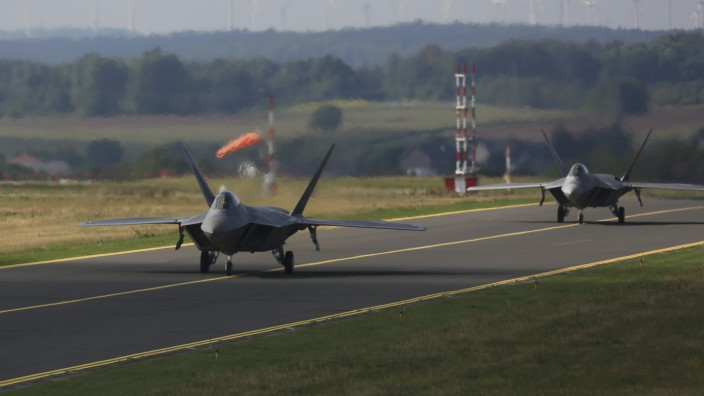 Two U.S. Air Force F-22 Raptor fighter jets taxi on tarmac at the Spangdahlem Air base