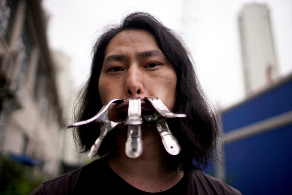 Brother Nut, Chinese performance artist, poses for a picture in Shanghai