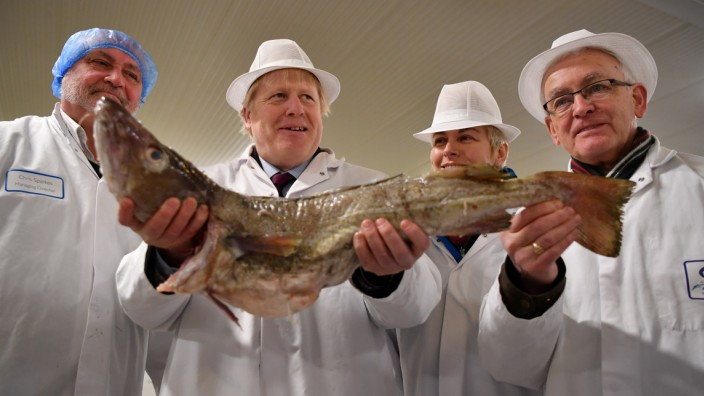 Britain's Prime Minister Boris Johnson visits Grimsby Fish Market in Grimsby