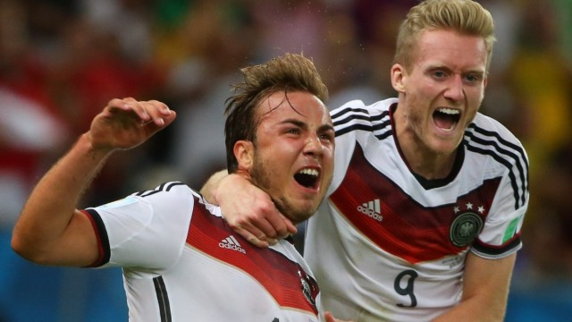 ITAR-TASS: RIO DE JANEIRO, BRAZIL. JULY 13, 2014. Germany s Mario Goetze (L) celebrates scoring the winning goal in the; WM 2014