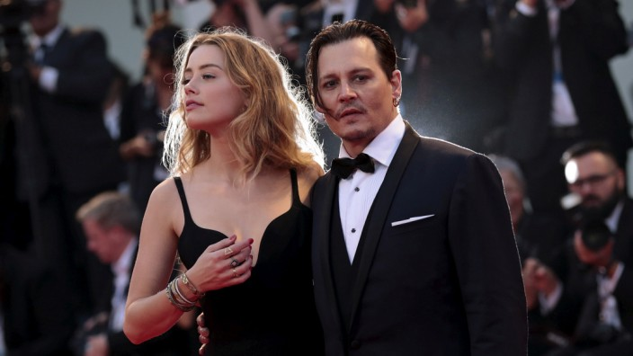 FILE PHOTO: Actor Depp and his wife Heard attend the red carpet event for the movie 'Black Mass' at the 72nd Venice Film Festival