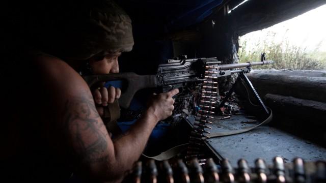 A Ukrainian serviceman is seen at a position on the front line near Novotoshkivske