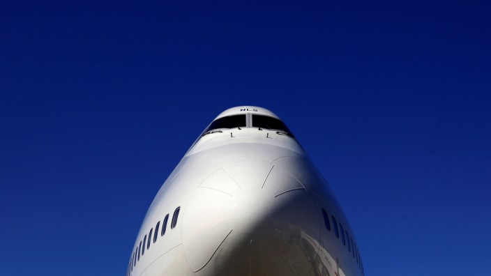 FILE PHOTO: A British Airways Boeing 747 passenger aircraft is parked at Heathrow Airport in west London
