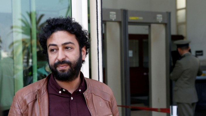 FILE PHOTO: Journalist and activist Omar Radi waits outside court in Casablanca