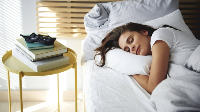 Portrait of woman sleeping in bed by daylight model released Symbolfoto property released PUBLICATIO