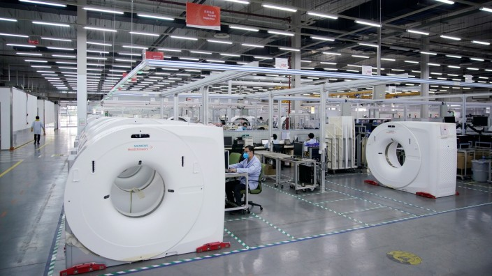 FILE PHOTO: A workshop of computed tomography (CT) scanners of medical device firm Siemens Healthineers in Shanghai, China