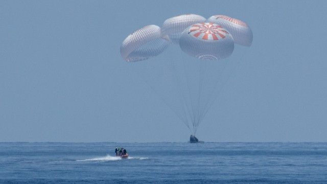 The SpaceX Crew Dragon Endeavour spacecraft is seen as it lands with NASA astronauts Robert Behnken and Douglas Hurley onboard in the Gulf of Mexico off the coast of Pensacola, Florida