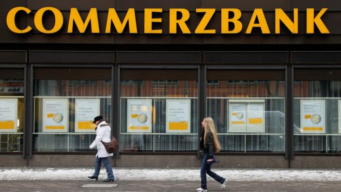 FILE PHOTO: People walk past a branch of Commerzbank in Berlin